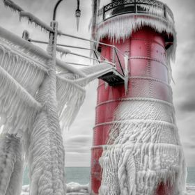 A different view of the lighthouse in south haven michigan. It's part of a series I've worked on through several winters for several ye...