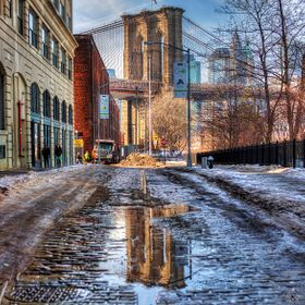 The melting snow around Brooklyn has created some large puddles which in turn create some awesome imagery.