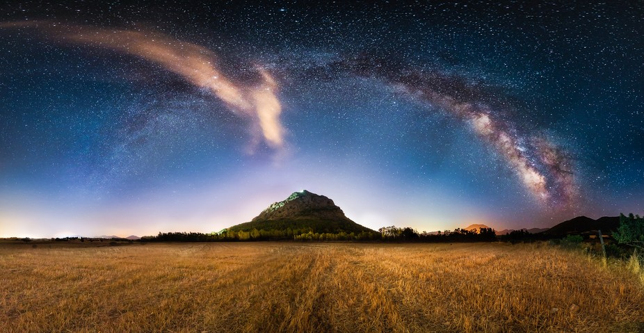 Panoramic view of the milky way arch at the Acquafredda Castle.In the valley of Cixerri, Sardinia...