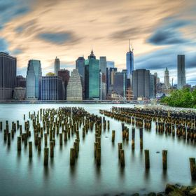 A cloudy day over New York City as seen from Brooklyn Bridge Park.