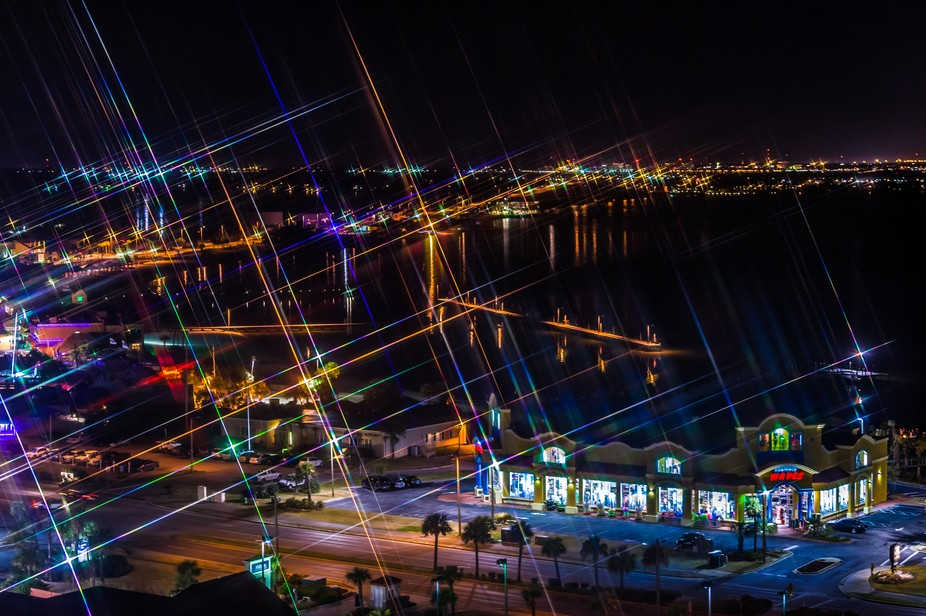 A view of Pensacola Bay at night using a cross-screen filter.