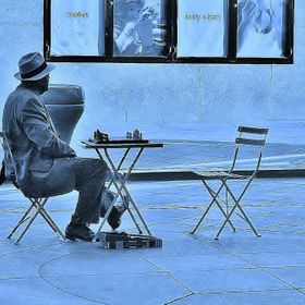 Early in the morning to start his day An elderly gentlemen sits & waits in his neat, spiffy suit & hat for any takers to play a game of chess he ...