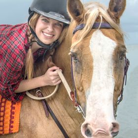 Alanah enjoying beach ride with Billy, the smiling horse. His smile is as beautiful as Alanah's.