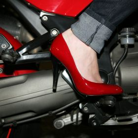 Red high heel on a red Motor  Guzzi motorbike with denim jeans. Taken at night with a single on camera flash. Picture is as shot without any post...