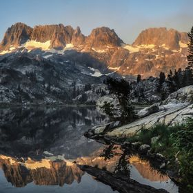 Reflection of the mountains on Ediza Lake on a smoky morning in the Ansel Adams Wilderness.