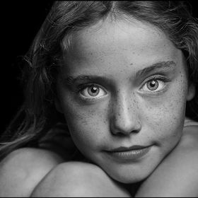 A black and white portrait of a young girl