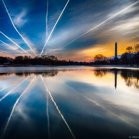 The Washington Monument shares its reflection upon the still waters of a winter morning.