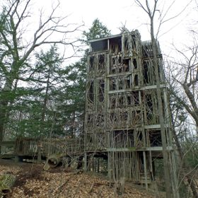 This tree house was on the Tree House Masters Show on animal planet.  Ithaca High School Class of 2000 Built it.   http://en.wikipedia.org/wiki/C...