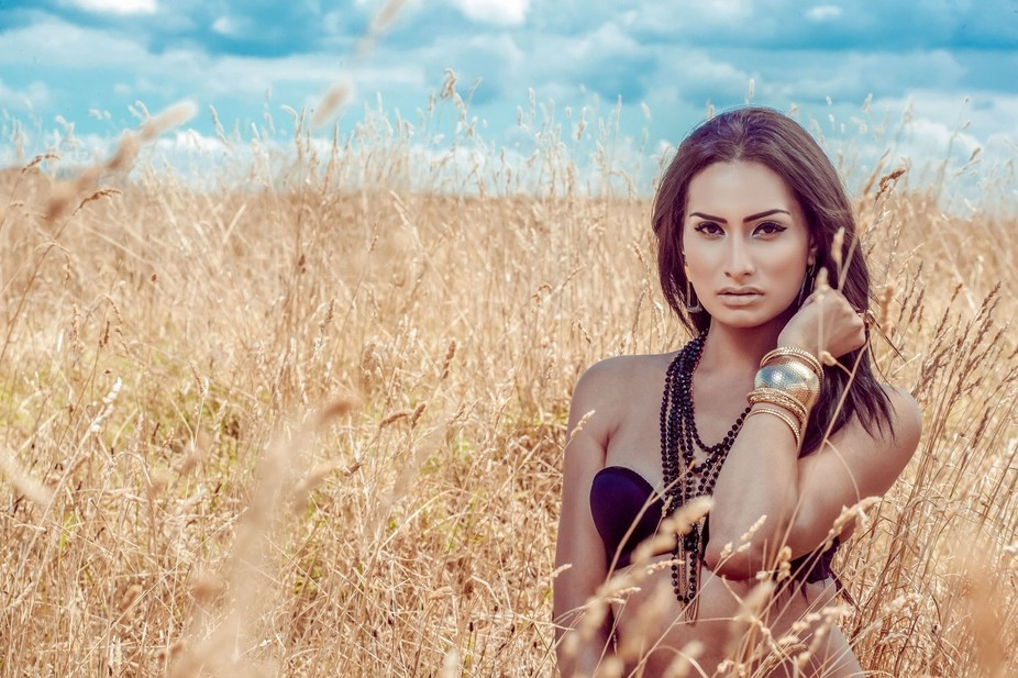 Transgender girl in a field of grass during the midday sun