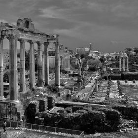 View of the Roman Forum at the left side the two arches were not taken, one  is under renovation and the Colosseum is visible in the background.Y...