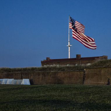 Two flags flying over Fort McHenry - the large one, a hand stitched replica of the one that flew during the penning of the Star Spangled Banner.