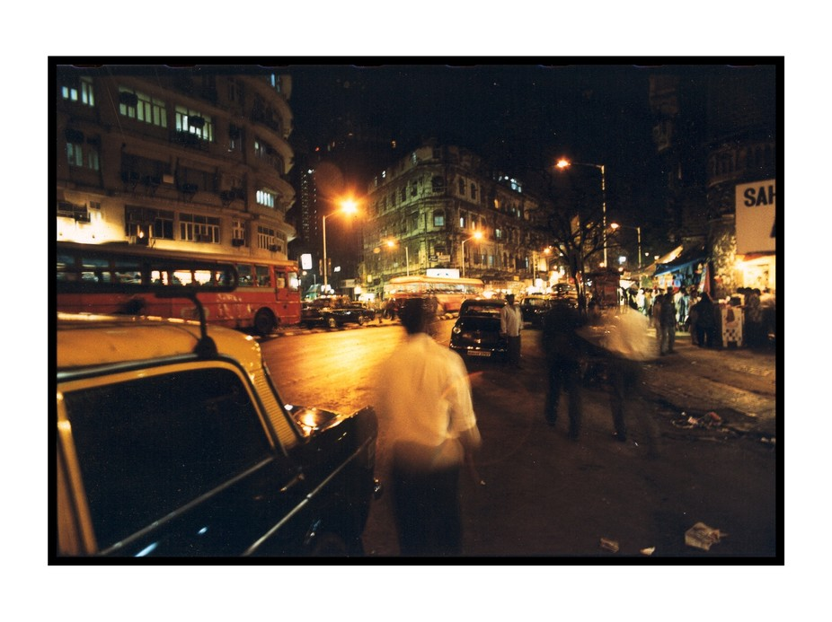 I took this picture in 1998 in Mumbai (Bombay), India, at night time. it was shot on film (I thin...