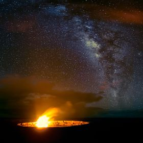 Where earth and sky meet together. The volcano at Volcanoes National Park, Big Island Hawaii as lights up the Milky way.