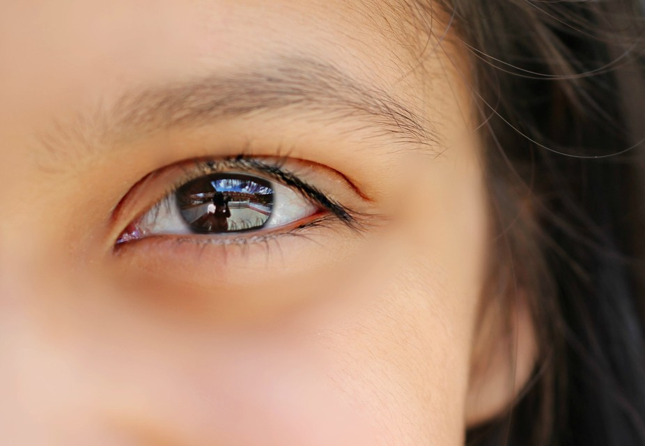 This is  a cropped version   for  better details  of myself  reflected  through my daughters  eye...