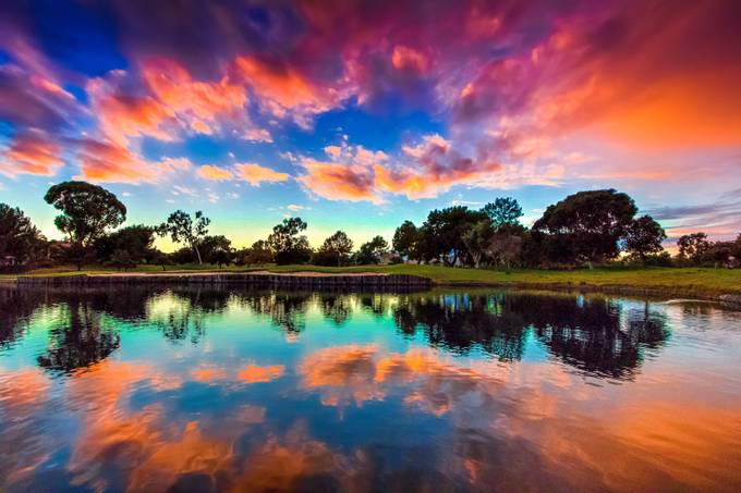 Dramatic golf course sunset by Temu0014 - Light On Water Photo Contest