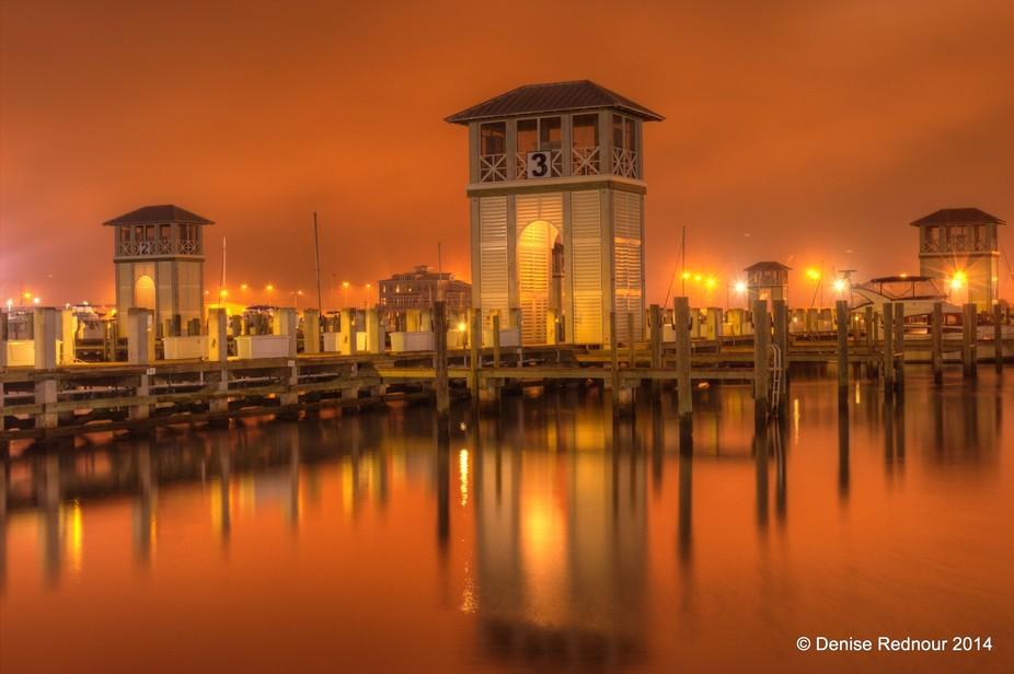 Sunrise at the harbor in Gulfport, Mississippi by Denise Rednour
