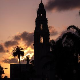 Balboa Park's Museum of Man tower silhouetted by the setting sun.