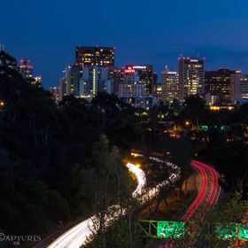 Long exposure over a freeway overpass during a busy night in downtown San Diego, CA.
