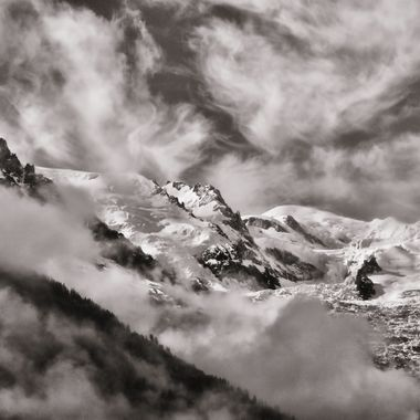 Early mist and clouds rising over Mont Blanc and Aiguille du Midi.