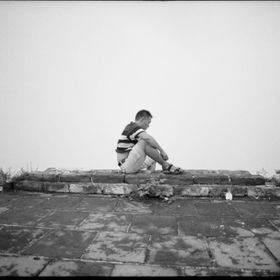 Taken with Mamiya 645 at Chinese Wall.   A solitary Chinese man sits on the Chinese Wall.  Year 2011.