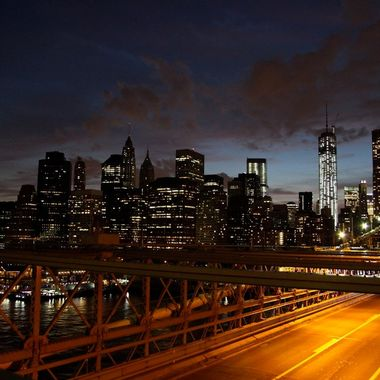 Manhattan skyline at rush hour shot on a time lapse from Brooklyn Bridge