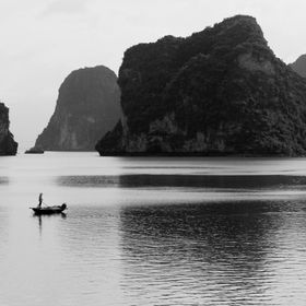 Drifting through the quiet morning morning waters of Halong Bay