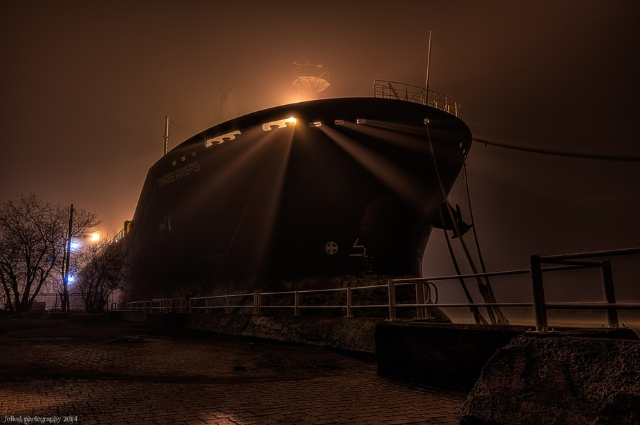 Three Rivers Cargo ship in the harbor fog after midnight