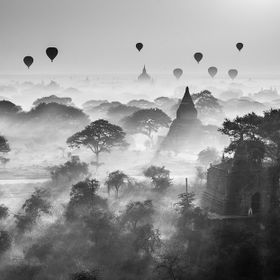 Lots of balloons are serving tourists to oversee the beautiful sunrise of Bagan, which is an ancient city  located in the Mandalay Region of Burm...