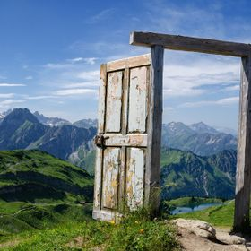 The old wooden door was standig loose along the trail leading to the Seealpsee (which you can see when you look through the door). The door with ...