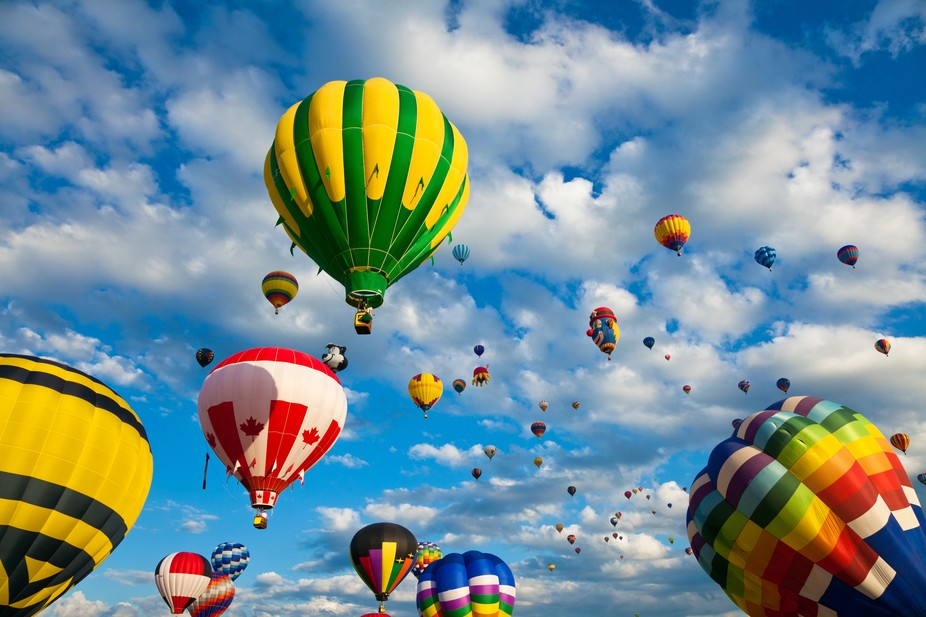 Hot air balloons in flight, from a yearly festival held in August in the town of Saint-Jean-sur-R...