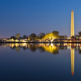 Long exposure dawn scenery featuring the Washington Monument as seen from the Tidal Basin in Washington DC, USA.