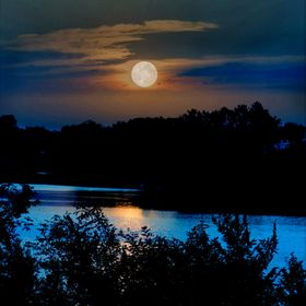 A full moon over the Arkansas river as it runs through central Kansas.  The trees silhouetted nicely in this image against a sky that was slowly ...
