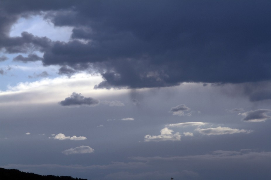 Golden hour during thunderstorm in the Northern Black Hills of South Dakota.