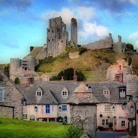 The ruins of Corfe Castle overlooking the square in the village. A famous Landmark in Dorset.