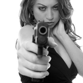 Model Jessica Vaugn with a gun