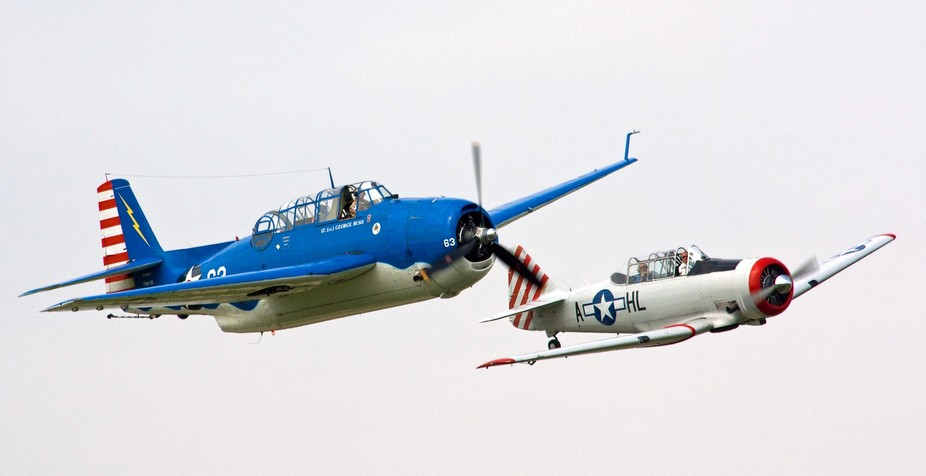 Two WWII Warbirds in formation.