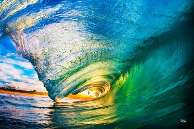 Inside a perfect wave on sunrise!