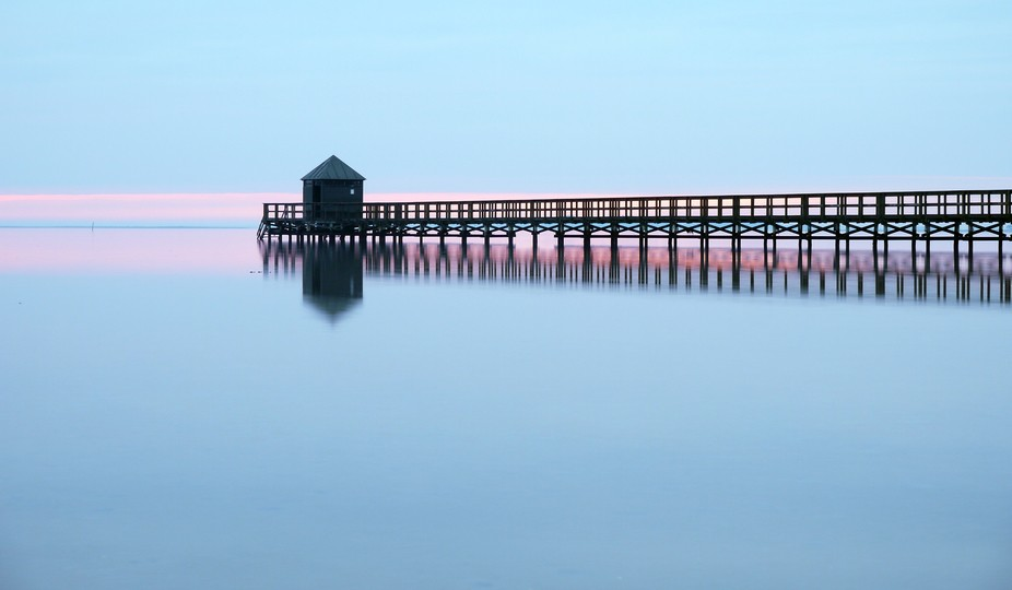 Winter 2014 Denmark. During early sunset in a crack of a moment this jetty  emerged.