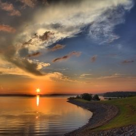 The sun sets over Lake O' The Pines in North East Texas near Jefferson, TX. This is an HDR composite from just one RAW image. http://lawrenceburn...