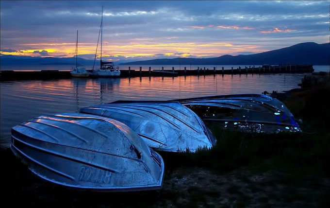 Three battered dinghies lay in wait for another days fishing, Alonnah, Bruny Island, Tasmania