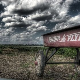vintage radio flyer wagon set against a dramatic Midwestern sky.