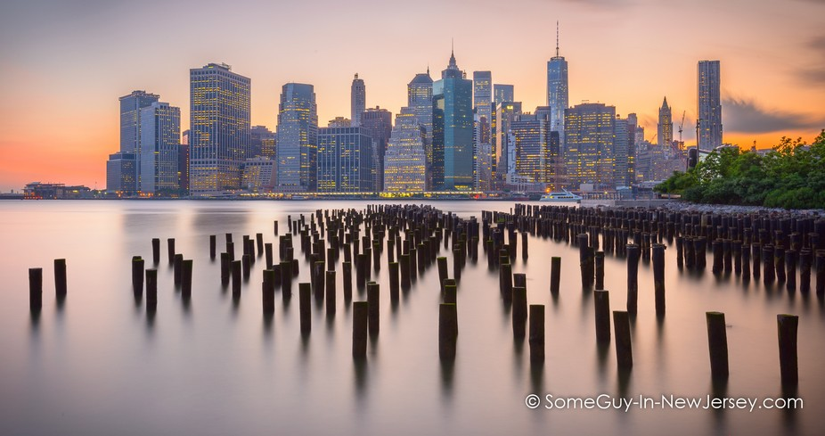 Two minute exposure of the towers of the Financial District at sunset. The wooden uprights of old...