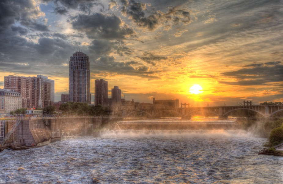Viewed from the Stone Arch Bridge in Minneapolis the Sunset over St. Anthony Falls was very inter...