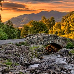Ashness Bridge is perhaps the most photographed packhorse bridge in the Lake District. This photo of the iconic bridge was taken with the sun set...