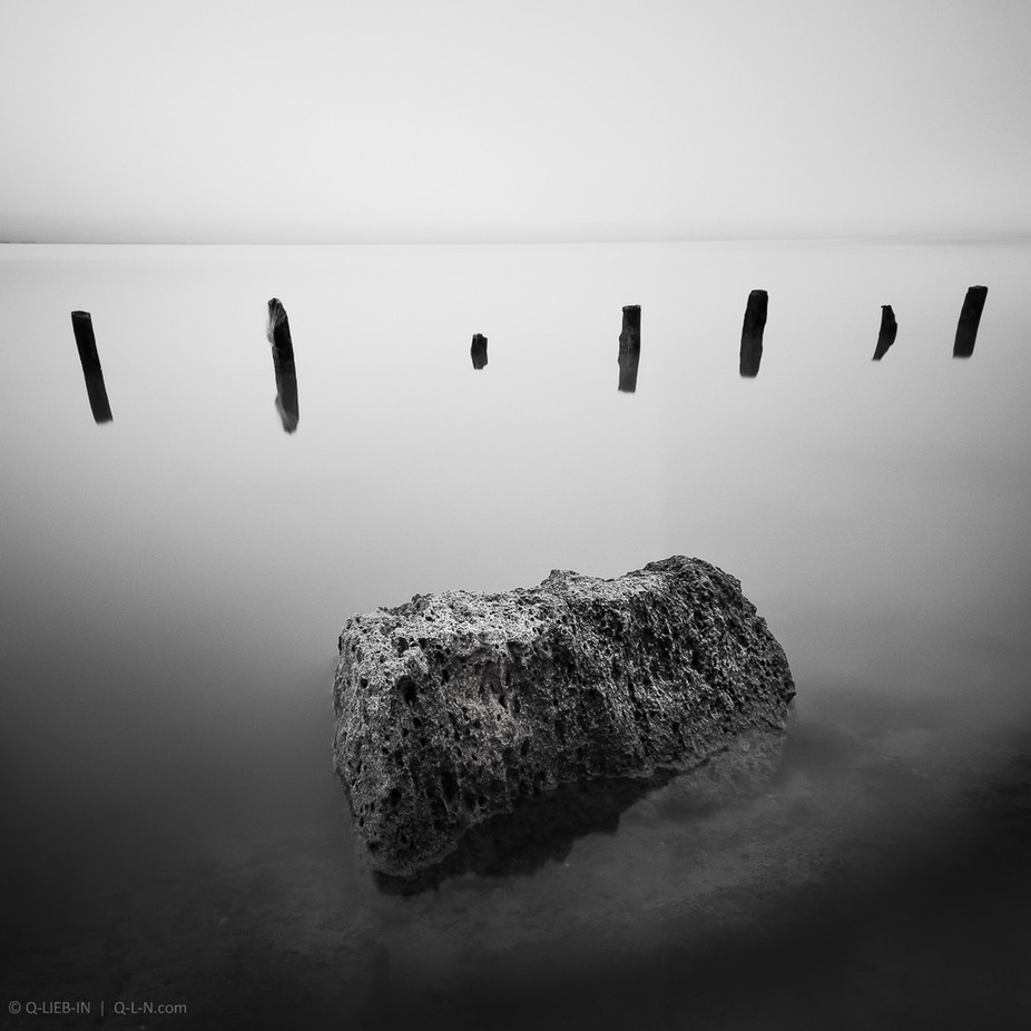 One boulder and seven poles by q-liebin - The Water In Black And White Photo Contest