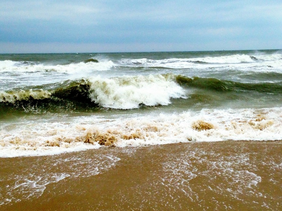 Waves crash violently into the sand of Virginia beach, Virginia on Independence Day weekend just ...