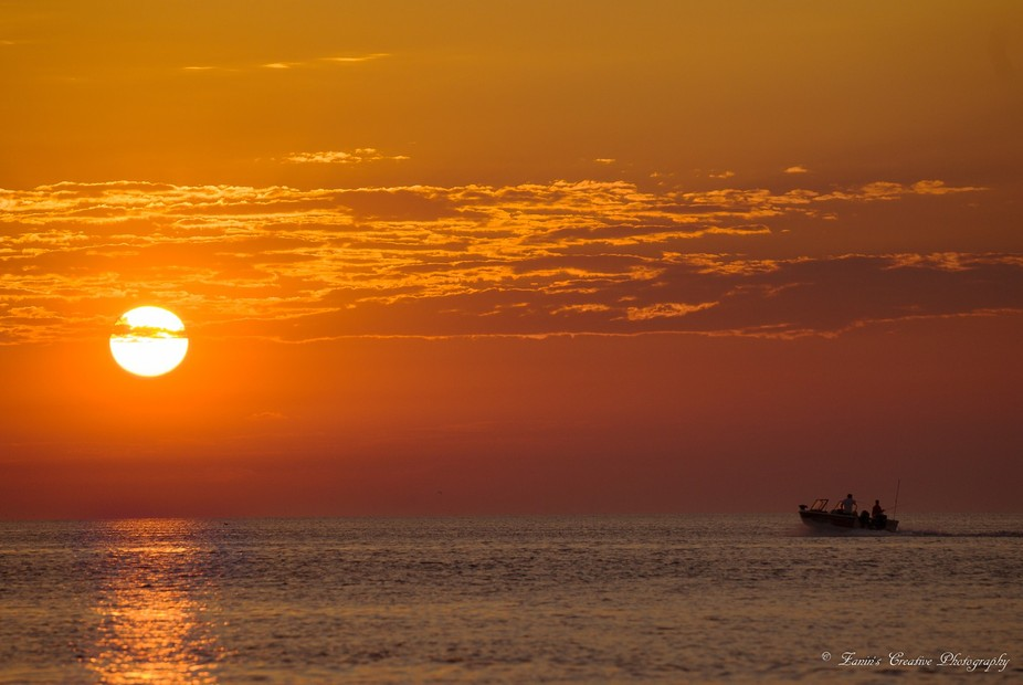 Fishermen out for that basket full of fish on this perfect sun rise.