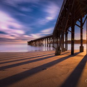 The pier at San Simeon casts some gorgeous sunset shadows.