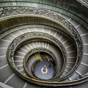 The monumental double spiral staircase designed by Giuseppe Momo helical to the Vatican Museums and opened December 7, 1932 © Carlo Marras Photo...