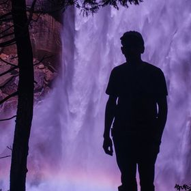 This is a photo of me in front of Vernal Falls that I shot in Yosemite NP.  It is hard to see, but there is a rainbow created in the midst across...